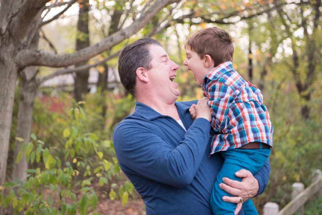 Dad laughing with son
