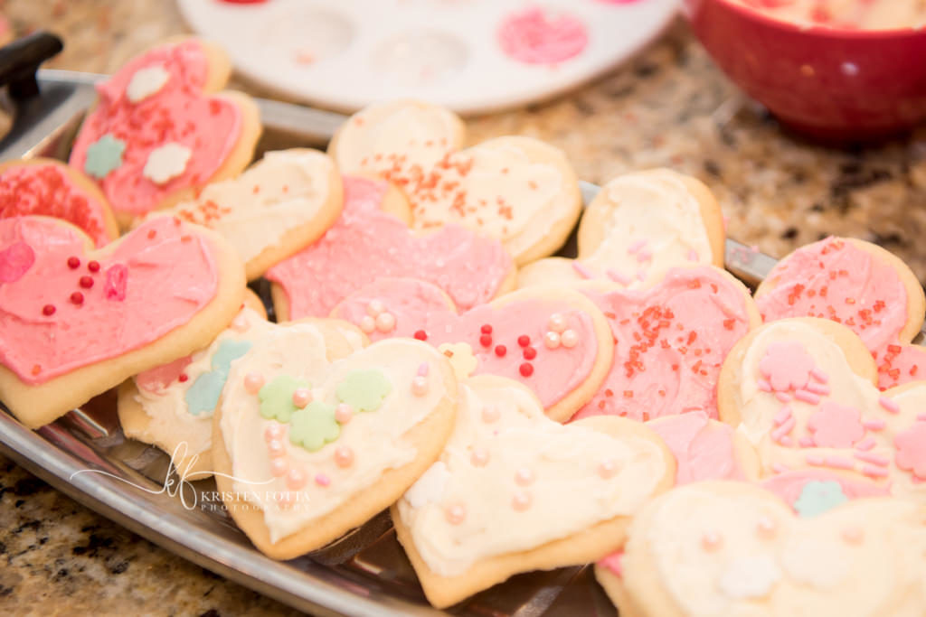 close up of a plate of child decorated Valentine cookies
