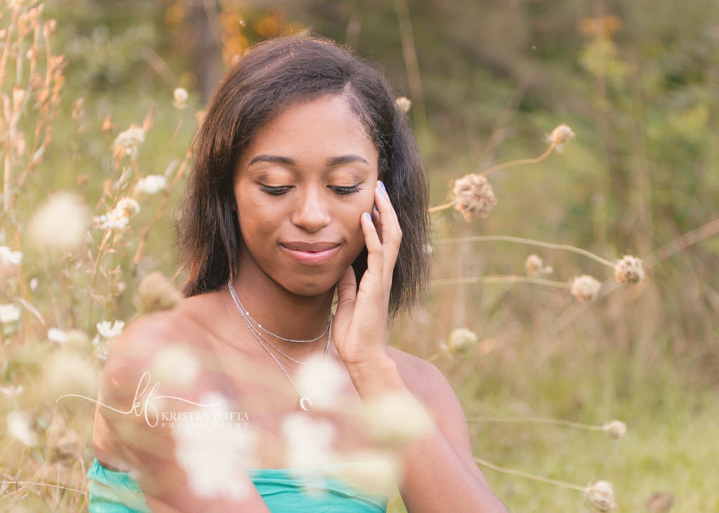 senior girl in wild flower field