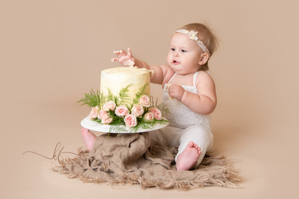 baby diving into cake smash cake