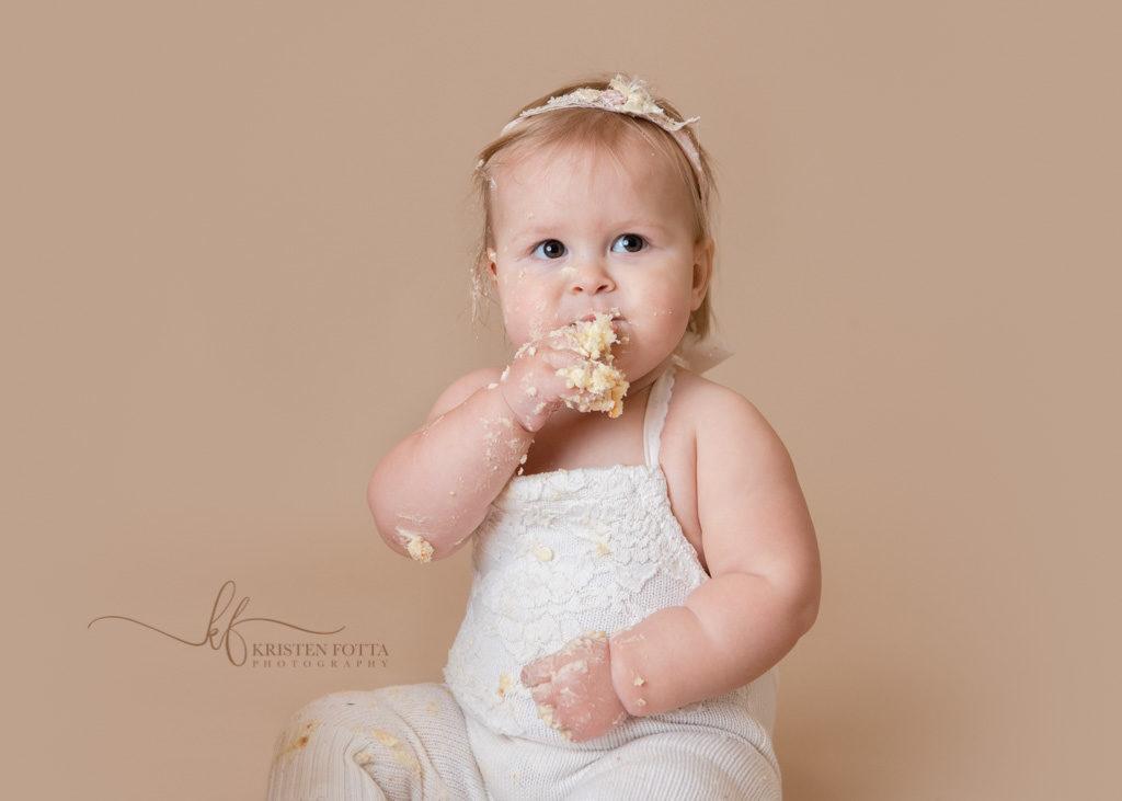 baby tasting her cake