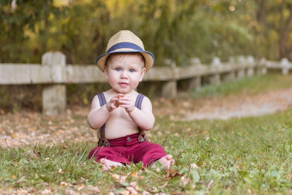 baby boy wearing suspenders and fedor