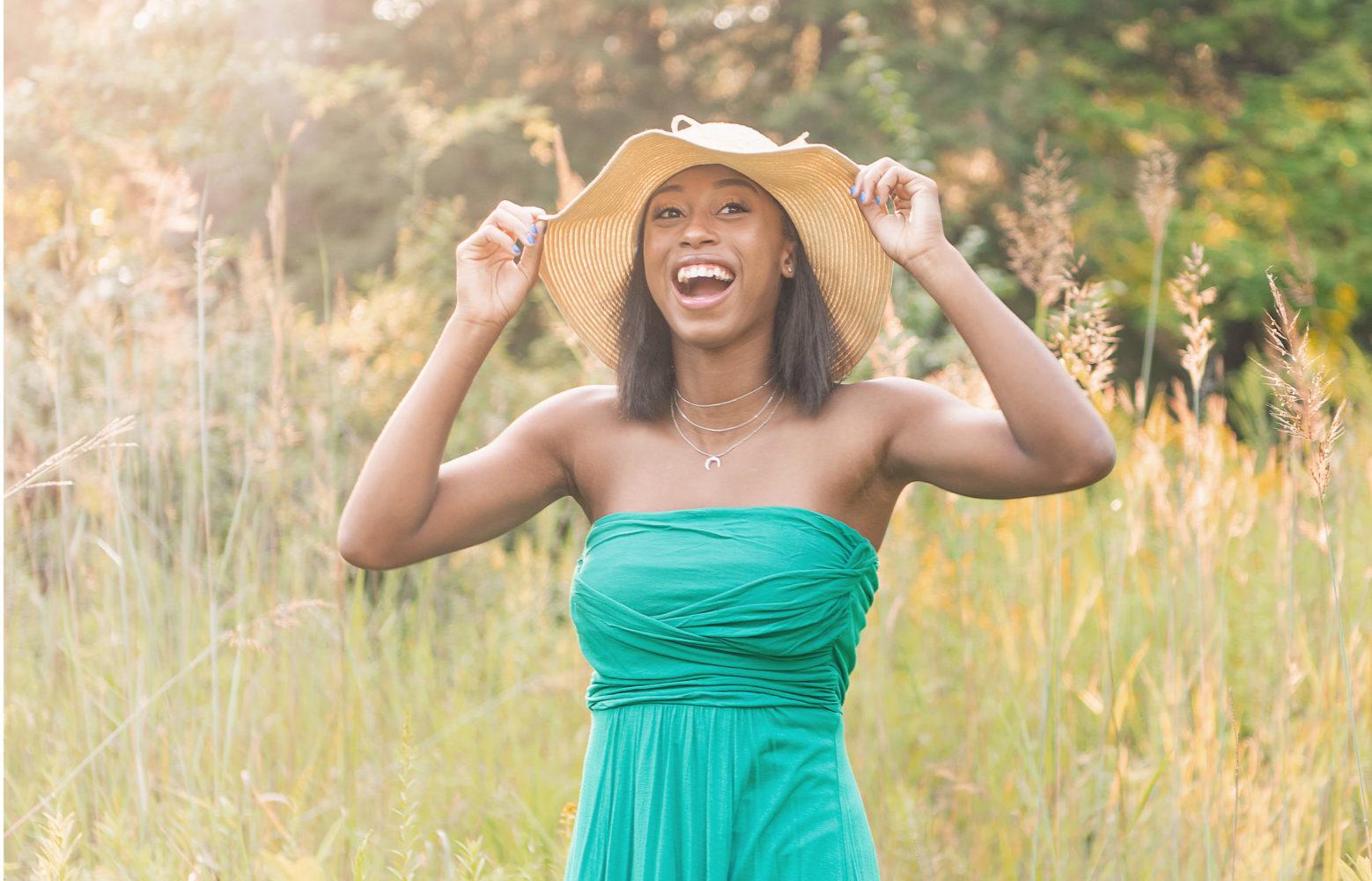 senior girl in sundress laughing
