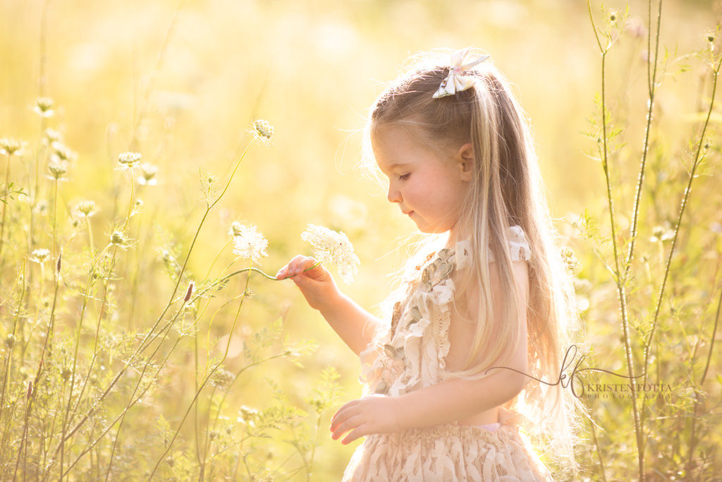 Little girl in wildflower field