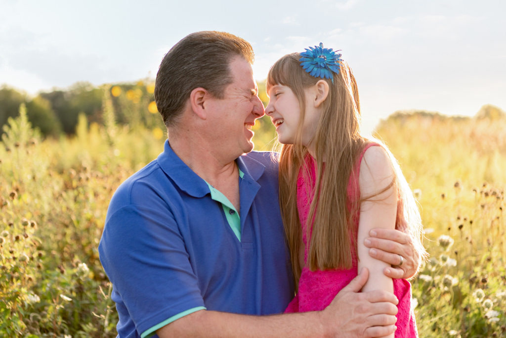 daddy daughter picture in wild flower field