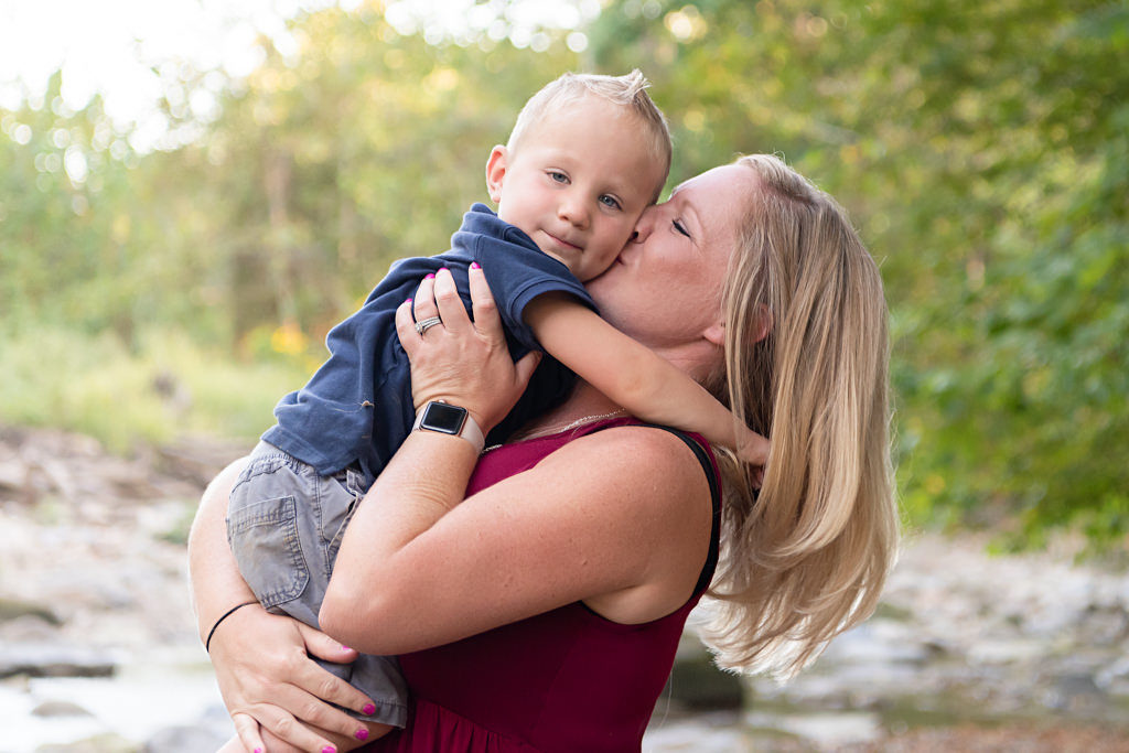 mom kissing her little boy