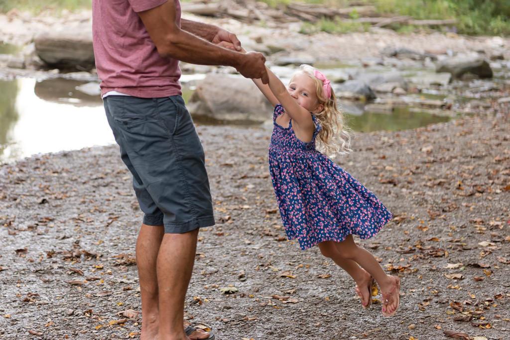 dad swinging daughter around