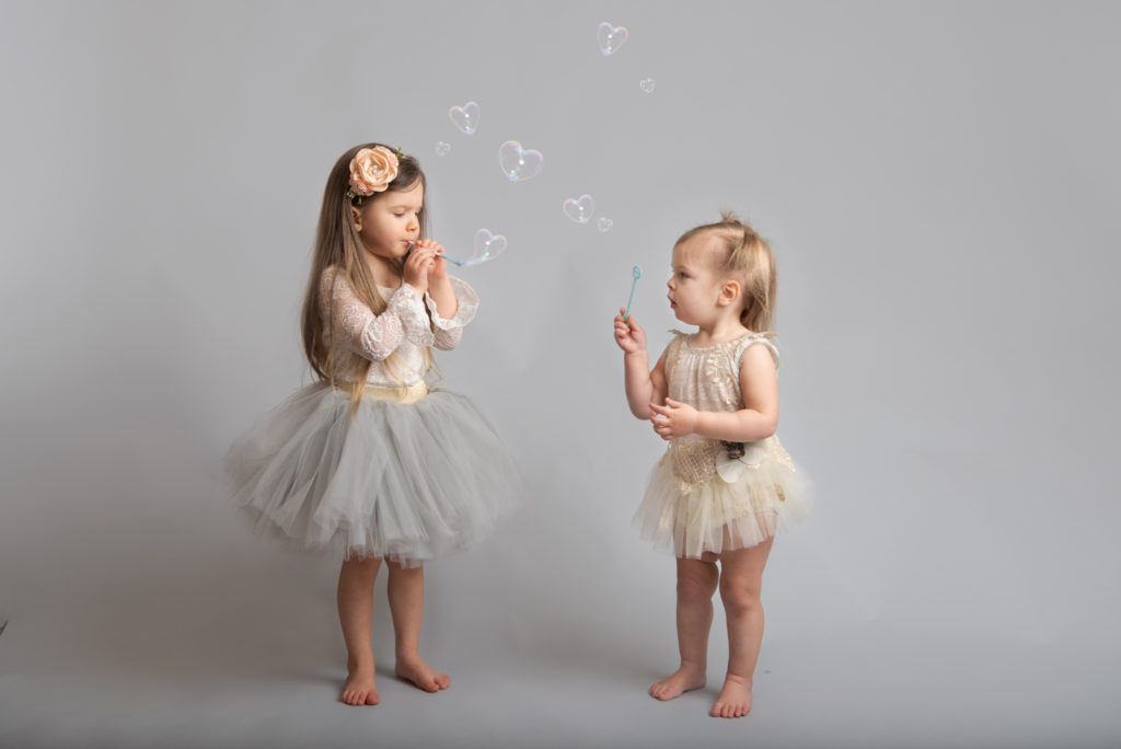 Blowing heart shaped bubbles for a creative Valentine Mini session